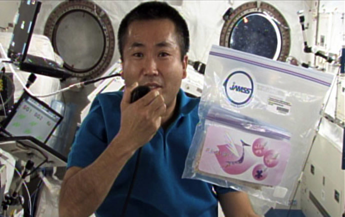 Koichi Wakata, seen here, with the cherry blossom seeds aboard the International Space Station.