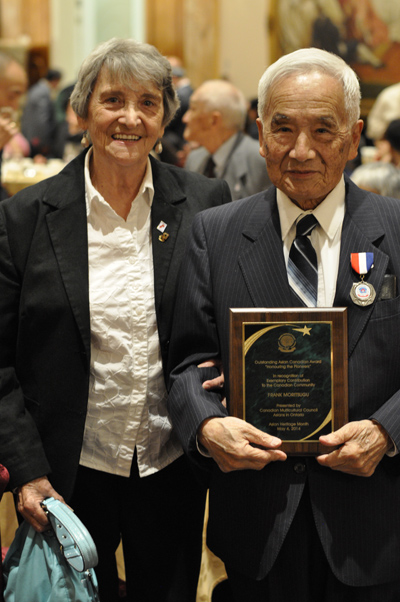 Betty and Frank Moritsugu at the gala night with the commemorative plaque given to Frank.