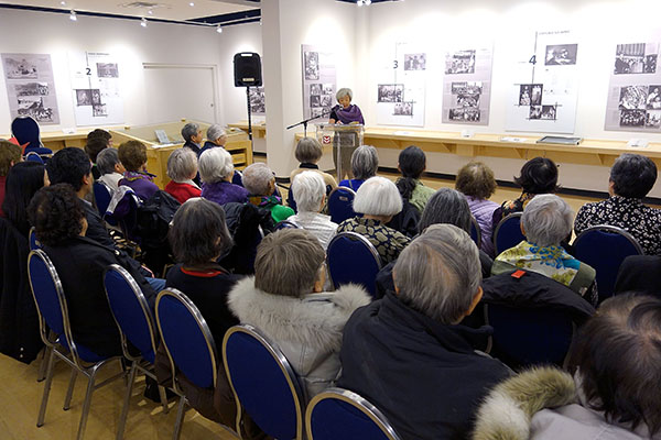 Diana Morita Cole, at the front, doing a reading for an audience at the Japanese Canadian Cultural Centre of her new book.
