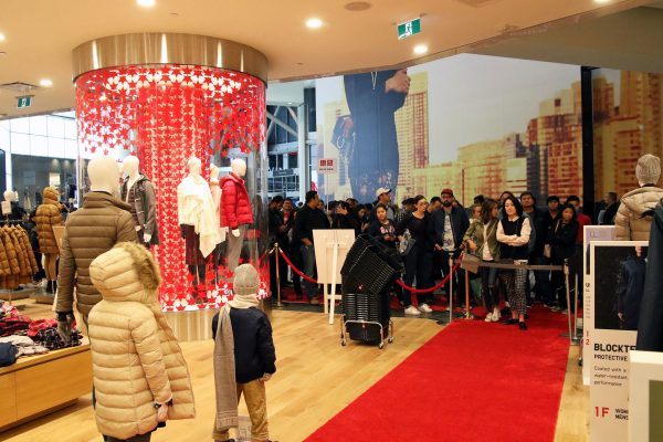 Shoppers eagerly wait at the entrance to Uniqlo's Eaton Centre location. Photo courtesy: Dr. Jonathan Eto.