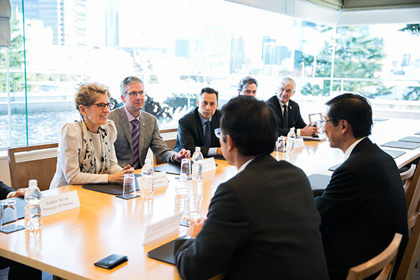 Ontario Premier Kathleen Wynne, left, discussed opportunities to strengthen aerospace partnerships with Sumitomo Precision Products business leaders in Tokyo. Ontario's vibrant aerospace industry generates over $6 billion in annual sales and employs more than 21,000 skilled workers in the province. Shown with Premier Wynne are, from left: Ambassador of Canada to Japan, Ian Burney, Minister of Economic Development and Growth, Brad Duguid, Trevor Dauphinee, Vice-President, Ontario Investment Office and Ray Tanguay, Auto Advisor to the Government of Ontario and Industry Canada. Seated opposite, are, from left: Natsuo Hashimoto, Managing Director , Sumitomo Precision Products, and Yoshio Taoka, Executive Vice-President, Sumitomo Precision Products. This official Ontario Government photograph is being made available only for publication by news organizations and/or for personal use by the subject(s) of the photograph. The photograph may not be manipulated in any way. © Queen's Printer for Ontario, 2016