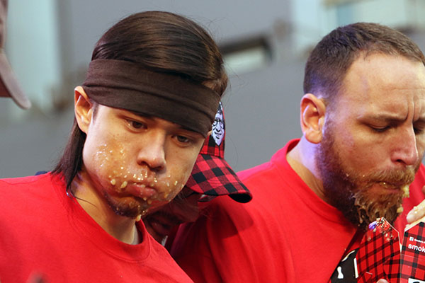 Stonie looking a little full, during the Smoke's Poutinerie eating competition. Photo credit: Dr. Jonathan Eto.